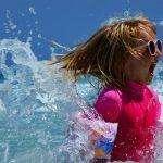 Girl yelling in the ocean