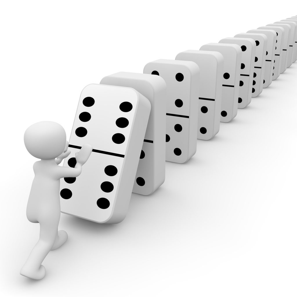 domino dice falling as a chain reaction