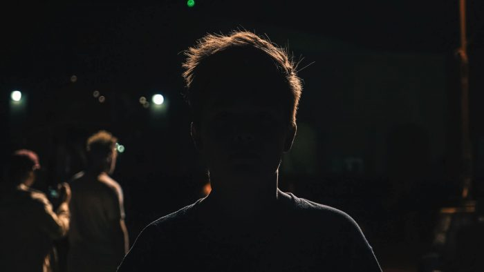 Silhouette of a man at a college party in US