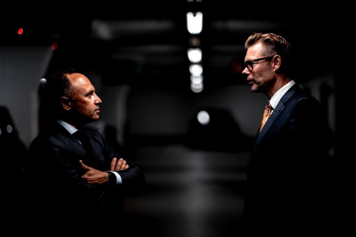 two businessmen in suits in the wall street garage