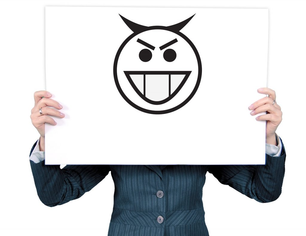 Man holding a board with evil smile