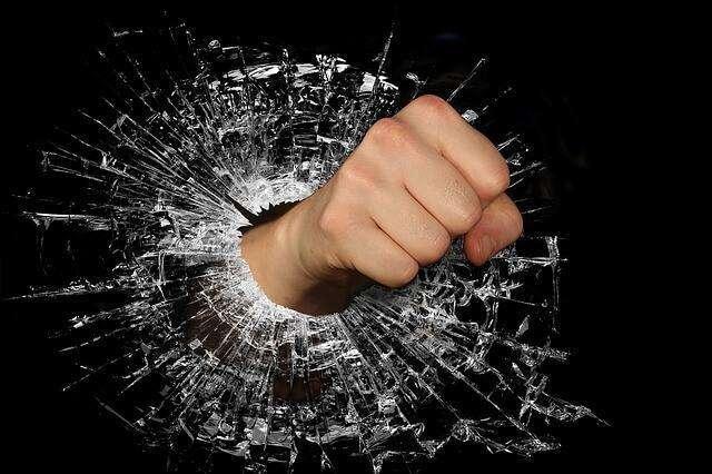 fist crashing computer screen anger